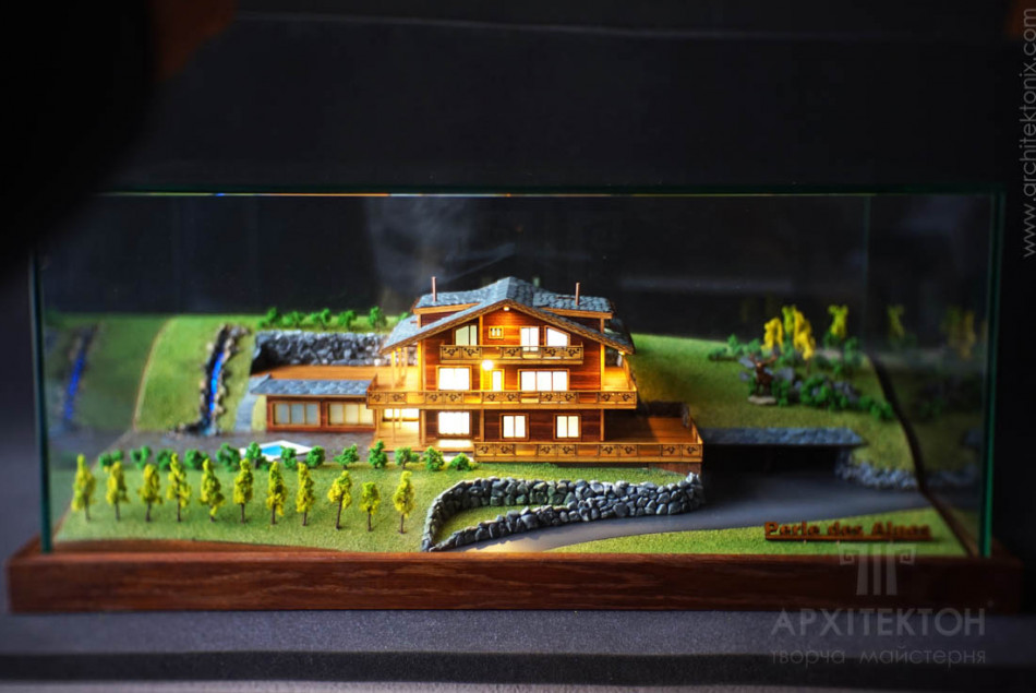 Architectural model of a cottage made of wood