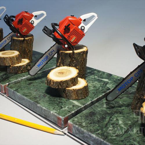 Scale souvenir model of chainsaw