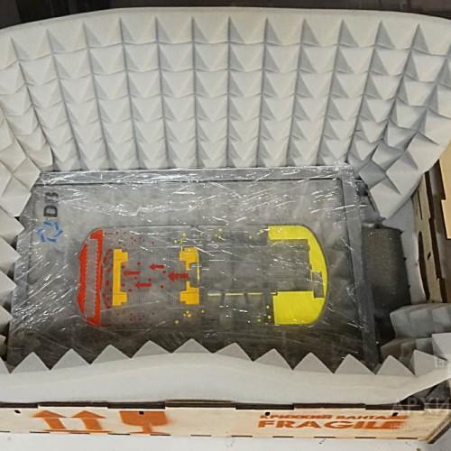 Model in plywood packaging with shock absorbing gasket
